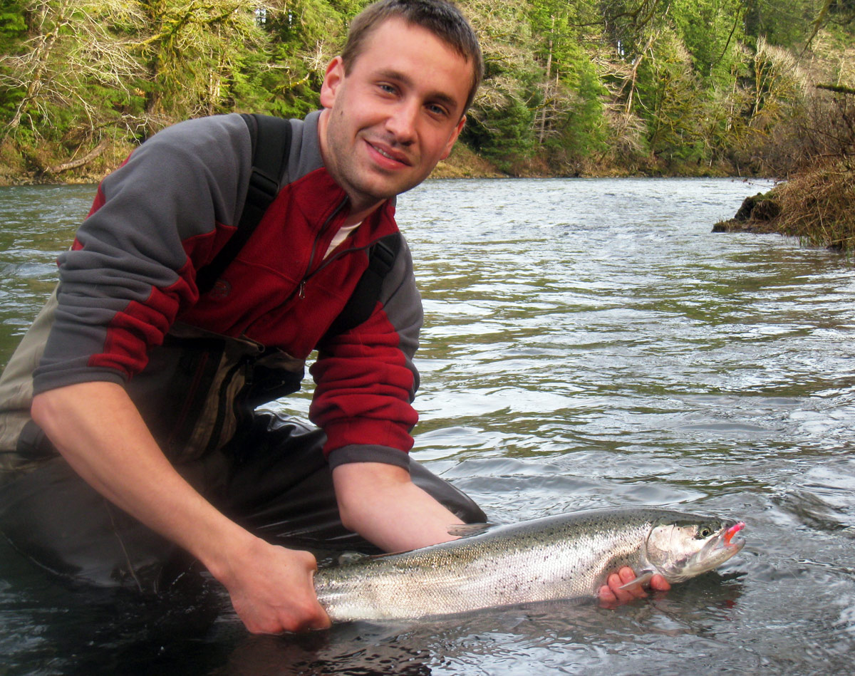 I'm a happy camper after landing this beauty on the Sol Duc River with guide Bill Meyer.