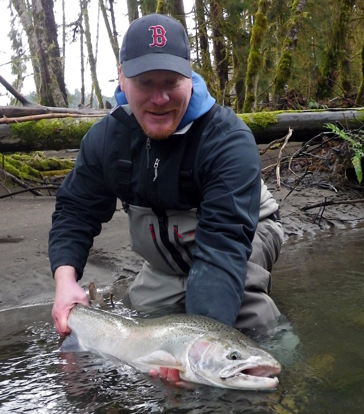 Kevin releases a Wild Steelhead during his first trip on the Clearwater River in Washington's Olympic Peninsula.